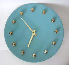 Atomic Metal Wall Clock in Aqua and Gold