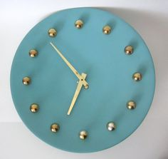 Atomic Metal Wall Clock in Aqua and Gold