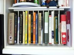 A built-in plate rack used to hold cook books #organizing #repurpose & Reuse tupperware as drawer organizers. #organizing #repurpose | New ...