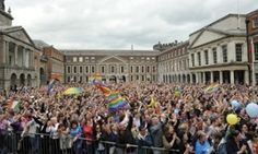 Crowds celebrate the landslide yes victory at Dublin castle.
