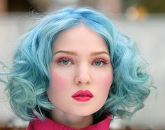 pink eyeshadow and blue hair….