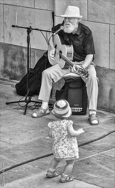 A little girl gets in the groove on the streets of Paris