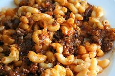 """Sloppy Joe Mac & Cheese Casserole- 1 lb of ground beef,1 small onion  1 can sloppy joe Manwich  1 box Kraft Macaroni & cheese  1/4 cup seasoned bread crumbs   Cook the meat & onion and until brown, remove and drain.Add 1 can of sloppy Joe Manwich to  meat mixture, set aside.Make the macaroni cheese as directed.Mix the meat/sloppy joe mixture into macaroni and cheese. top with bread crumbs.   Put into a greased square pan and put into 350""""f oven for approximately 1/2 hour."""