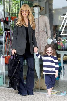 Rachel Zoe and Skyler pose for pictures in front of her clothing line at Kitson