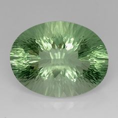 Oval Concave Cut Green Fluorite - Gemstone Image