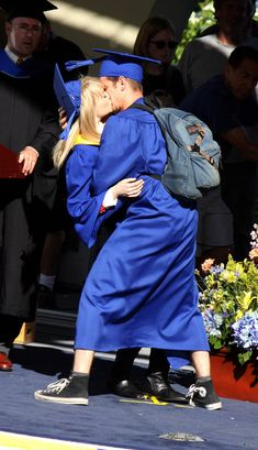 Emma Stone and Andrew Garfield share a kiss on the set of their movie The Amazing Spider-Man 2 while filming a graduation scene in New York City.