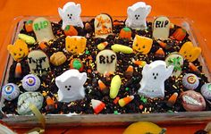 Spooktacular Halloween Graveyard Cake: Rely on a boxed cake mix and store-bought candy to make this easy party sweet.