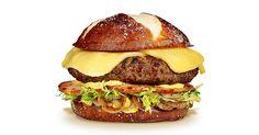 The Rhinelander featuring Wisconsin Butterkase, Beer Mustard, Smoked Ham, Sautéed Onions, and Frisée Lettuce on a  Pretzel Bun