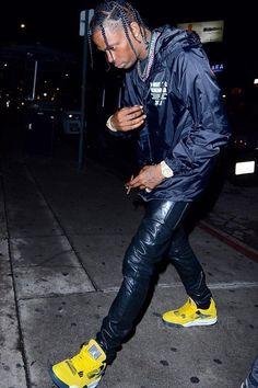 Travis Scott wearing  Saint Laurent Faux Leather Jeans, Fan Merchandise A Night to Remember 2017 Merch Jacket, Nike Air Jordan 4 Retro Sneaker