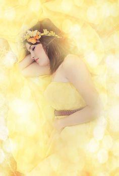 Dreamy ethereal yellow sleeping by NataschavNiekerk