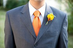 the darker suit with a touch of orange either in the tie only or the flower only is also nice