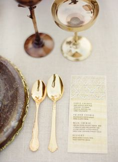 Antique gold and brass table setting + a small menu. #paper goods