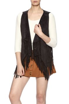 Black faux suede vest with an open front, fold over collar, and fringe trimming.   Faux Suede Vest by Blu Pepper. Clothing - Jackets, Coats & Blazers - Vests Nebraska