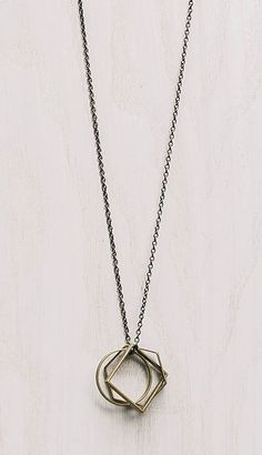 I love this brass geometric shapes pendant necklace. It seems like a real classic piece to keep in the wardrobe. www.annjaneliving.com