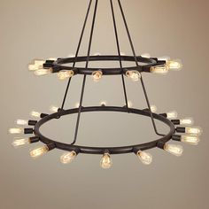 Versatile 2-tier metal chandelier in dark charcoal finish has a style that can work with just about any room decor. It's rustic, industrial and minimalist all in one cool design.