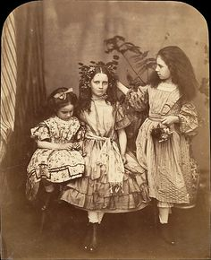 Print from about 1863 of Irene MacDonald, Flo Rankin, and Mary MacDonald at Elm Lodge. Print taken by Lewis Carroll, who was a friend of the family. It was to this family the Carroll original read the manuscript of the Adventures of Alice in Wonderland.