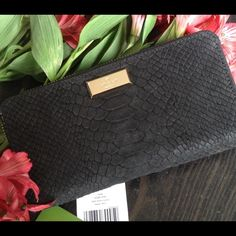 Elsie Street Exotic Neda Gorgeous matte snake with smooth leather trim and capital kate jacquard lining. Featuring 12 credit card slots, 3 bifolds, one zipper pocket and one exterior slide pocket. kate spade Bags Wallets