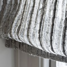This deconstructed linen sheer is woven, then cut into strips. The strips are attached to paper, embroidered together & then washed to dissolve away the paper. Each piece has its own unique, irregular character & beauty.