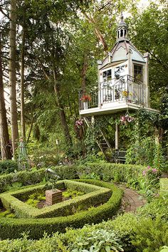 Kathy's tower overlooks her Medieval-inspired knot garden. The octagonal structure rests on a 12-foot-tall platform with steps and an iron railing.