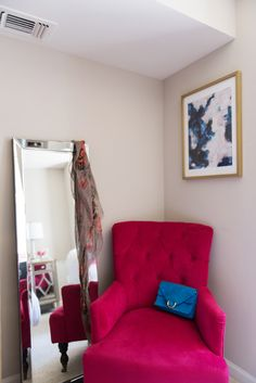pink world market chair, kirklands beveled mirror, styling area, blogger apartment tour - Bedroom Tour: Reading Nook With an Awesome IKEA Bookcase Hack by popular DC blogger Alice Tenise