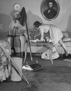 Jane busy straightening up before launching into some heavy cleaning with dust mop and carpet sweeper. Inside the demanding life of an American mother in 1941 1950s Housewife, Vintage Housewife, Vintage Photographs, Vintage Photos, Carpet Cleaning Business, Labor, Home Based Business, Life Magazine, How To Make Bed