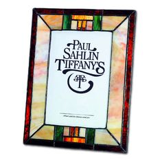 Colorful arts and crafts style art glass surrounds your photo in this picture frame, which holds a 4 x 6 inch photo.