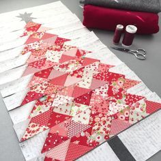 Another version of my tree pattern. I used modern background essentials fabric by for my background and little ruby collection by for my tree. The star is silver.Red Christmas tree quilt -- I love this, but would do it in dark green fabrics. Need quilt fo Noel Christmas, Christmas Projects, Holiday Crafts, Christmas Paper, Magical Christmas, Cottage Christmas, Purple Christmas, Coastal Christmas, Modern Christmas