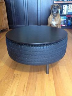 "tire table upcycle - looks like a ""man cave"" idea Tire Table, Tire Chairs, Tire Craft, Tire Furniture, Automotive Shops, Tyre Shop, Used Tires, Tyres Recycle, Creation Deco"