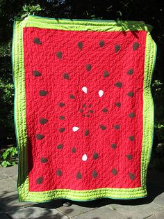 Calvin's watermelon quilt by aeolidia, via Flickr  A great summer picnic quilt. Great colors.