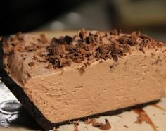 Easy No-Bake Nutella Cheesecake: Ingredients:  2/3 cup Nutella  1 8 oz block Cream Cheese (room temp)  1 tsp vanilla extract  1 8 oz container non-dairy whipped topping (defrosted)  1 Oreo Cookie Pie Crust  1 bar chocolate (optional).