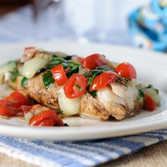 "Grilled Cod with Spinach and Tomatoes | ""Very tasty, easy and quick to make. Looks great on the plate. Also it provides a nice base to experiment a bit with some additional flavors - maybe basil, ginger, oregano."""