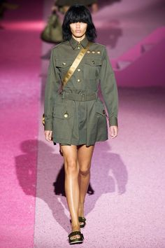 But the clothes stood up to the fun theatrics. Of course, one might expect a tongue-in-cheek ode to real housewives of the '50s or '60s with a pink house like that, but instead Jacobs did a 180 with louche military.  Imaxtree  - HarpersBAZAAR.com