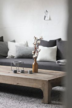 Love the rustic coffee table and comfy looking pillow backed sofa.  From STYLIZIMO BLOG: Grey living room