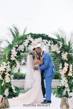 Petal Productions arranged a beautiful ceremony arch featuring fronds and flowers to match the couple's tropical venue. #weddingideas #wedding #marthstewartwedding #weddingplanning #weddingchecklist Simple Wedding Arch, Wedding Arch Rustic, Wedding Reception Decorations, Floral Wedding, Wedding Flowers, Wedding Arches, Wedding Chuppah, Wedding Ceremony, Ceremony Arch