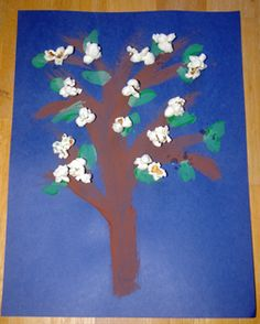 How to Make It: Children paint tree trunk and leaves and then glue on popcorn for blossoms!