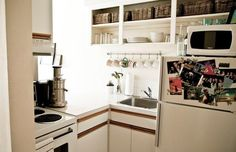 cool idea for kitchen: take off cabinet doors and fill shelves with baskets and make dishes visible