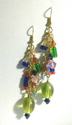 Check out this item in my Etsy shop https://www.etsy.com/listing/226485378/multicolored-beaded-glass-dangle