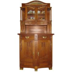 Absolutely exceptional rare Art Nouveau Wiener Werkstatte Buffet/Cupboard, probably designed by Josef Hoffman- with extraordinary construction- upper part doors come together at an inward closure, lower part doors- at an outward angle.Elegant columns, original painted glass, brass detailed handles and legs.Handcarved floral period decorations. 1910