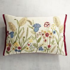 Mother Nature& fresh crop of wildflowers and wheat can barely be contained on the cotton canvas of our vibrant vignette, bordered in bright red. Applique Cushions, Floral Cushions, Cushions On Sofa, Diy Embroidered Pillow, Jacobean Embroidery, Cushion Cover Designs, Embroidery Flowers Pattern, Creative Embroidery, Brazilian Embroidery