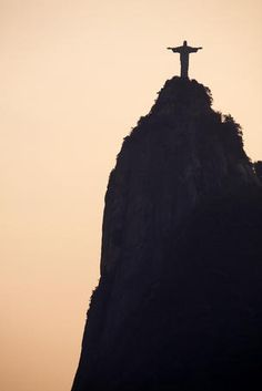 Jesus! you can move mountains! Silhouette of Cristo Redentor (Christ the Redeemer) statue on the summit of Corcovado.