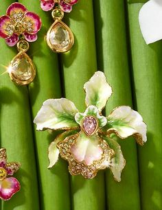 Anita Small Orchid Pin - Flora: A gift for someone special or just for you. Hand-painted layers of enamel finish our luminous Anita Small Orchid Pin with a porcelain patina. Carved metal is dipped in 18K gold and embellished with hand-set Swarovski® crystals.