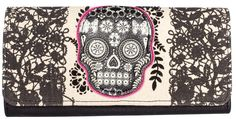 LOUNGEFLY LACE SKULL WALLET WITH FUSCHIA Loungefly has the lovely n lace skull wallet to keep your cash in line. This faux leather wallet features a natural canvas front flap with printed lace details, skull applique & flocked leaves. Inside is held tight with a magnetic snap closure, is lined with black & pink polka dot fabric & there is enough room to store all your cards & cash. $30.00