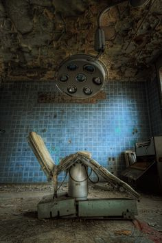 chair and operating lamp at an abandoned soviet hospital hidden by the forests of Germany.