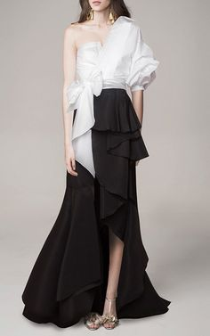 This **Johanna Ortiz** skirt is rendered in silk faille and features an a-line shape with an asymmetrical ruffled hem.