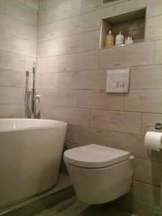 Wall Mounted Toilet And Freestanding Bath Creates An Illusion Of Depth In A Small E By Yvonne Lindsay
