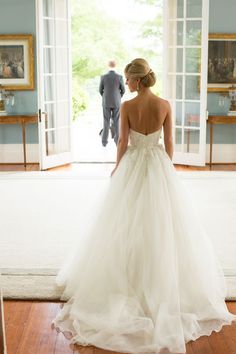 The bride was stunning in a strapless ball gown featuring an embroidered bodice. She wore her blonde hair into an elegant coiffure, which exposed glistening diamond earrings. #ballgown Photography: Aaron Watson Photography. Read More: http://www.insideweddings.com/weddings/classic-virgina-wedding-inspired-by-grace-kellys-elegance/511/