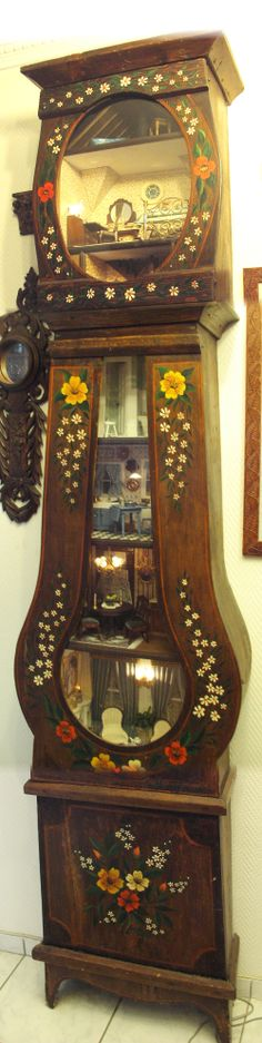 Doll house miniature rooms in a grandfather clock case. My first project finished 30 years ago.