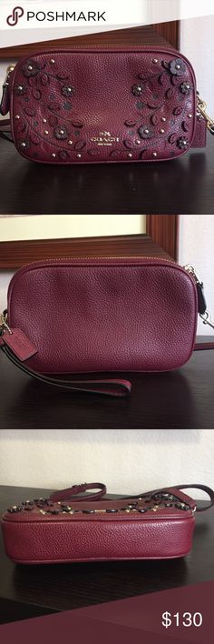 Coach Willow Floral Crossbody Clutch This Gorgeous Burgundy Leather Clutch Purse Is A Women's Must Have Accessory. Designed To Hold A Few Necessities Like A Driver's License, Cellphone, Credit Card And Other Small Essentials. Feel Free To Carry By Hand (Wristlet) Or Hanging From The Shoulder (Crossbody). Gently Used And In Great Condition And Perfect For Any Coach Lover ❤️ Dust Bag Not Included. Coach Bags Crossbody Bags
