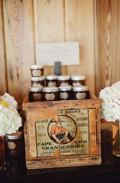 An old, wooden packing case used as table for favors. Sally Watts Photo