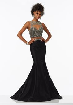 Prom Dresses by Morilee designed by Madeline Gardner. Halter Neckline and Two-Piece Prom Dress with Fully Beaded Bodice and Stretch Taffeta Skirt.